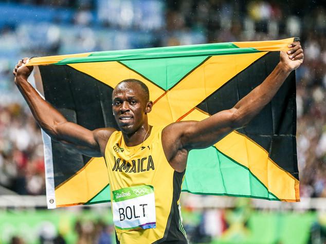 """""""The greatest"""", Bolt saluta i Giochi con tripla tripletta"""