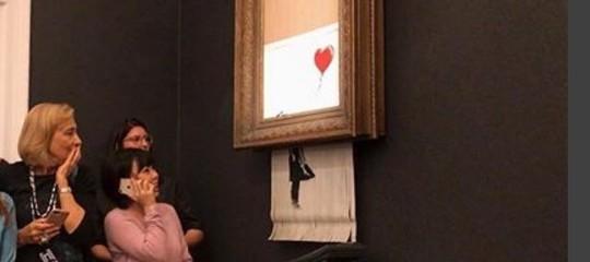 Arte:Banksyrivela il meccanismo di autodistruzione della sua opera