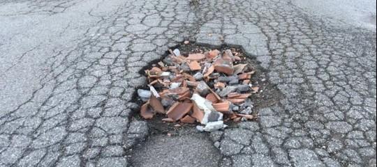 buche stradali roma